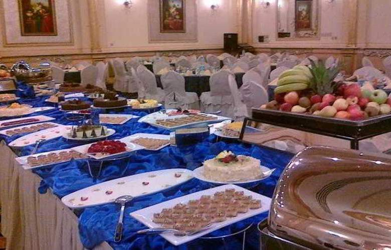 Holiday Inn Al Qasr - Restaurant - 8