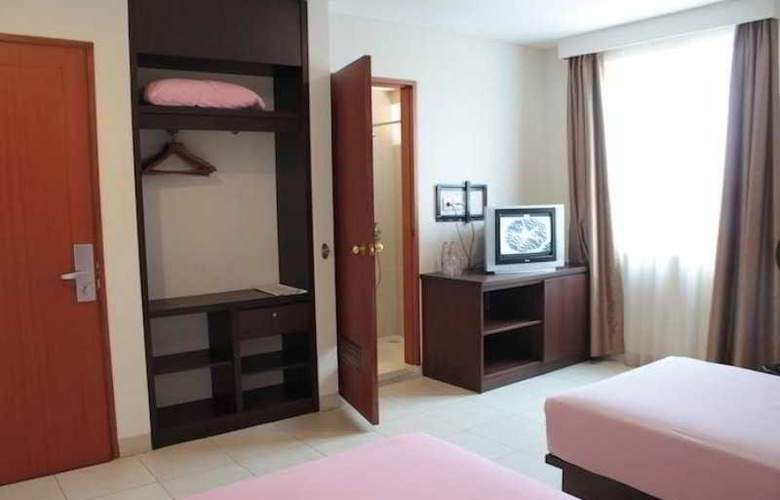 Losari Blok M Hotel - Room - 0