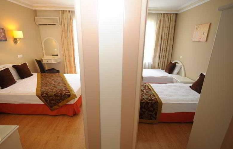 Suite Laguna Apart & Hotel - Room - 11
