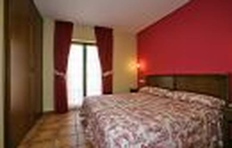 Apartamentos Villa de Cabrales - Room - 1