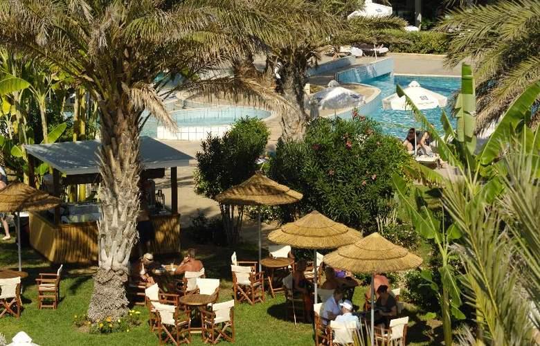 Constantinou Bros Athena Beach Hotel - Bar - 16