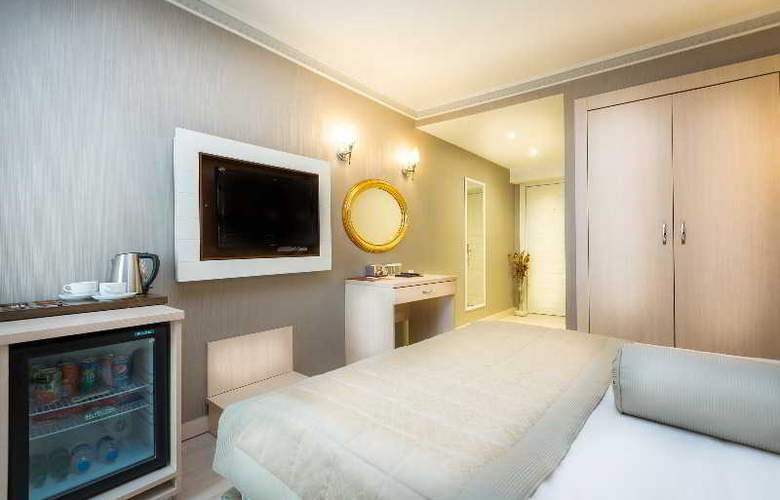 Osmanbey Fatih Hotel - Room - 8
