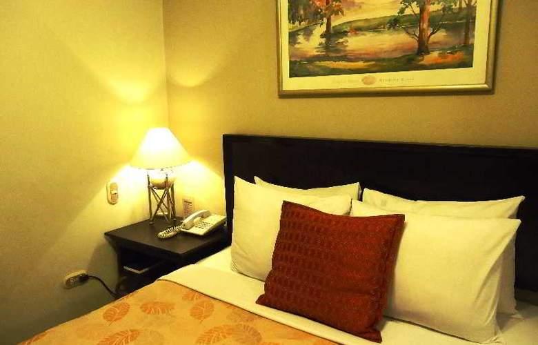 Leon de Oro Inn and Suites - Room - 3