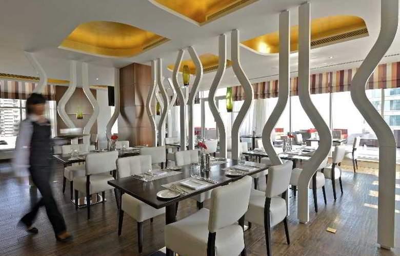 Swiss Belhotel Seef Bahrain - Restaurant - 18