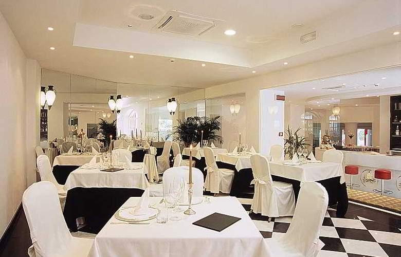 M Glamour Hotel - Restaurant - 9