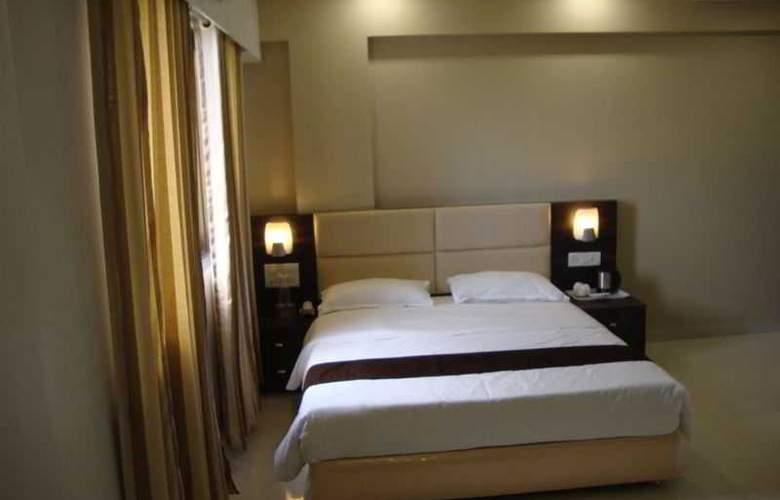 Galaxy Comforts - Room - 3