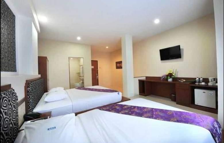 Gaja Hotel Pekanbaru - Room - 11