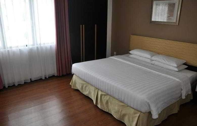 Likas Square Condotel - Room - 0