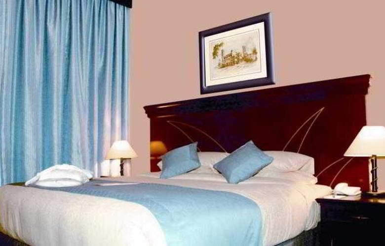 Al Jawhara Hotel Apartments - Room - 15