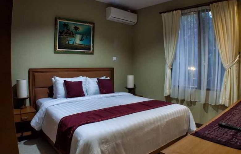 Kuta Puri Bungalow - Room - 13