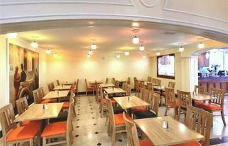 Wyndham Garden Hotel Baronne Plaza - Restaurant - 8