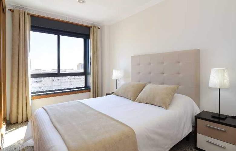 Apartamentos Nuria Sol - Room - 15