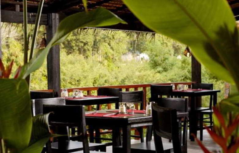 Motive Cottage Resort - Restaurant - 12