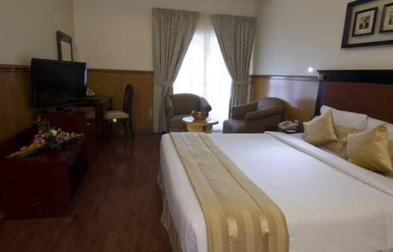Landmark Plaza - Room - 9