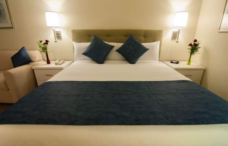 Quality Inn Maingate West - Room - 9