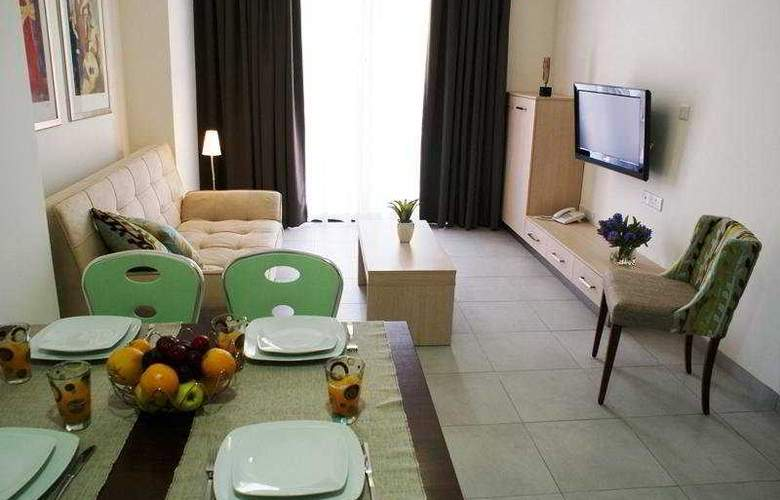 Anemi Hotel and Suites - Room - 2