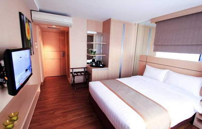 Petals Inn - Room - 2
