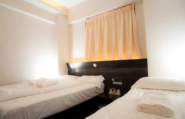 Homy Inn - Room - 11