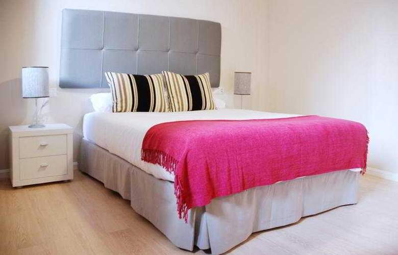 Apartamentos Metrópolis Sevilla - Room - 4