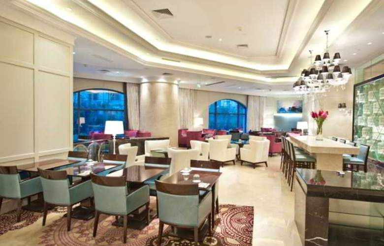 The One Executive Suite by Kempinski - Restaurant - 13