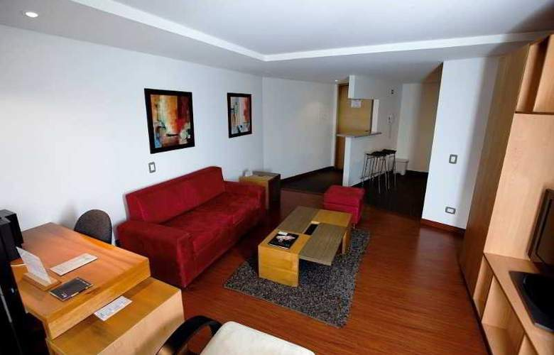 Travelers Apartamentos y Suites Obelisco - Room - 1