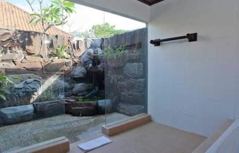 Adi Assri Beach Cottages Singaraja - Room - 16