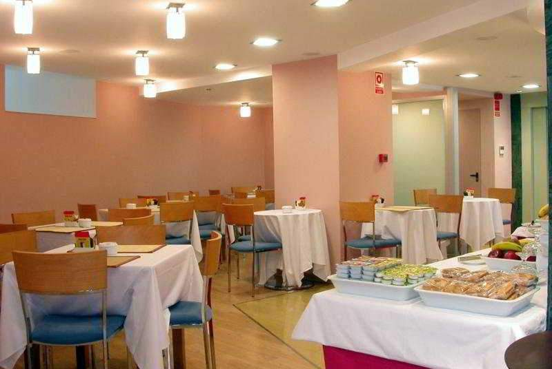 Exe Puerta de San Pedro - Restaurant - 13
